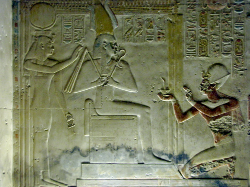 Seti I before Osiris and Isis